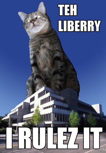 Image of a giant cat sitting on top of a library buidling with the words 'Teh Liberry - I Rulez It'