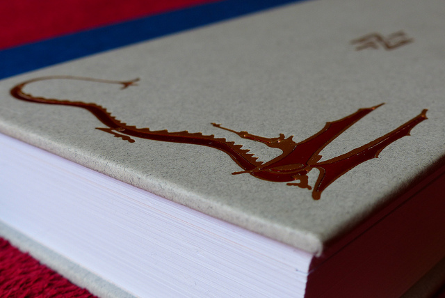 Image of part of the cover of 'The Hobbit Deluxe Edition' from J. R. R. Tolkien, showing a red dragon.