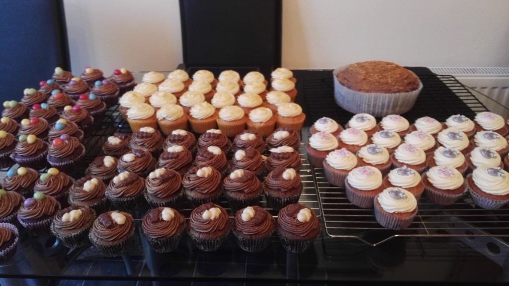 A photograph of various home-made cupcakes