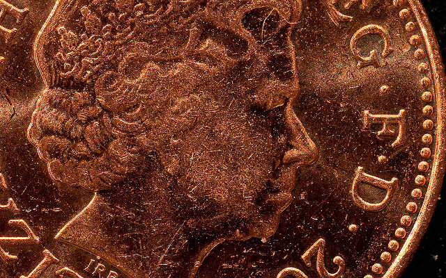 Photograph showing a detail of a one pence coin.