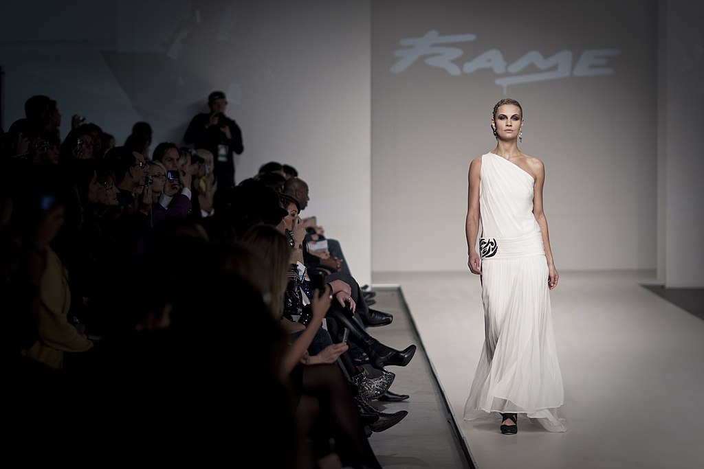 A photograph showing a model on a cat walk. From Spring/Summer 2010 runway show Toronto.
